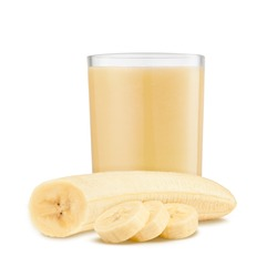 Fresh banana shake in a glass and banana pieces isolated on white background