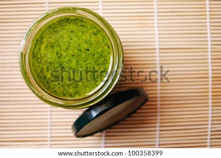 Fresh basil pesto, typical italian green sauce dressing for pasta