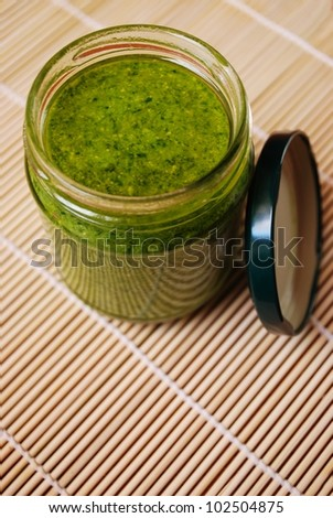 Fresh basil pesto, typical italian green sauce dressing for pasta