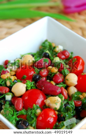 Fresh bean salad in a white bowl