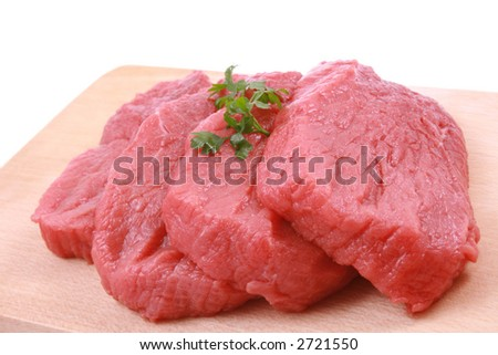 fresh beef on board ready to cook isolated on white