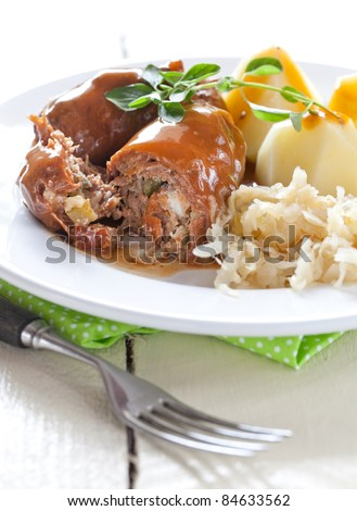 fresh beef roulade with potatoes and sauerkraut