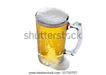 fresh beer in a large frosted glass mug isolated on white
