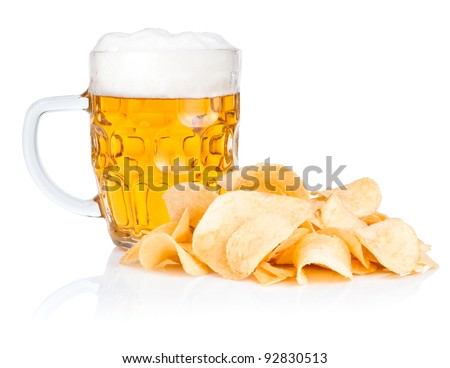 Fresh beer Mug with foam and  Pile of potato chips Isolated on white background