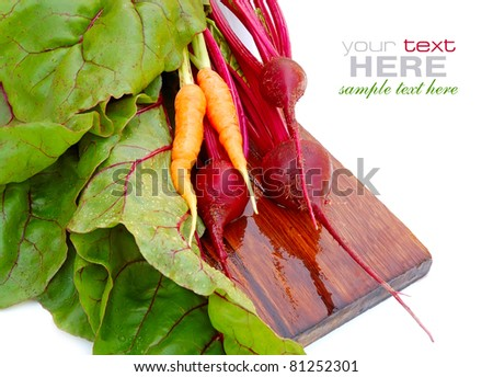 Fresh beet roots and carrot on a white background