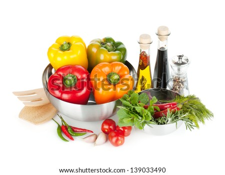 Fresh bell peppers, herbs and condiments. Isolated on white background