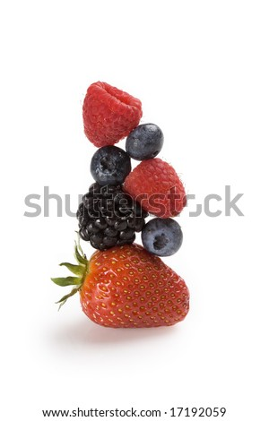 Fresh berries balanced on top of each other - stock photo