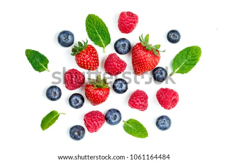 Fresh berries isolated on white background, top view. Strawberry, Raspberry, Blueberry and Mint leaf, flat lay\r