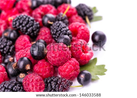 Fresh berries: raspberries, blackcurrants, mulberries isolated on white background