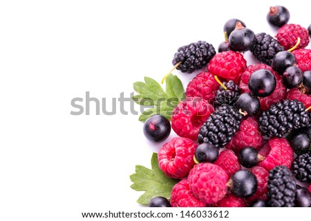 Fresh berries: raspberries, blackcurrants, mulberries isolated on white background