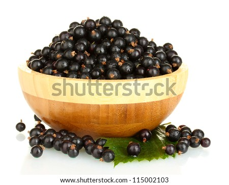 Fresh black currant in wooden bowl isolated on white