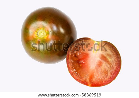fresh black tomato isolated on white