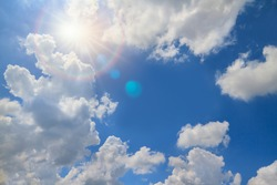 Fresh blue sky with soft and fluffy clouds, Sky after raining with sun halo like God blessing
