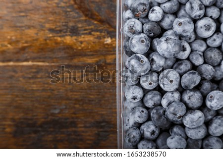 Fresh blueberries in a plastic container. Concept of healthy and dieting eating.