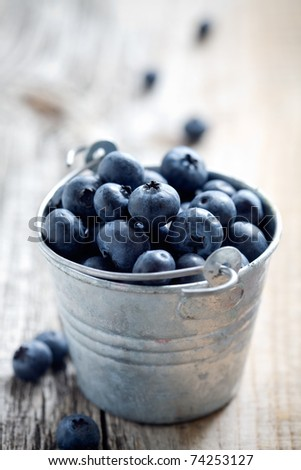 Fresh blueberries in small bucket, selective focus