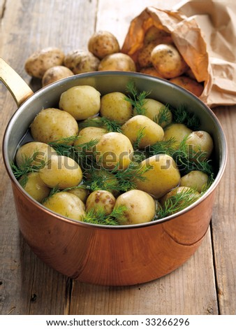 Fresh boiled potatoes with dill