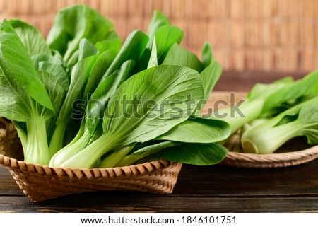 Fresh Bok Choy or Pak Choi(Chinese cabbage) in bamboo basket on wooden background, Organic vegetables ストックフォト ©