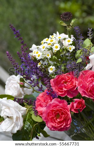 Fresh bouquet of rose with lavender on green background