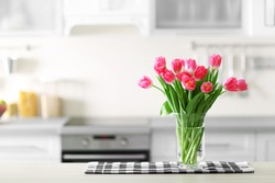 Fresh bouquet of tulips on a kitchen table.