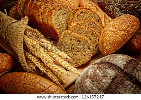 fresh bread  and wheat on the wooden