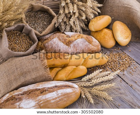 fresh bread and wheat on the wooden #305502080
