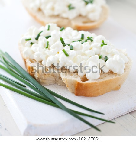 fresh bread with curd and chives