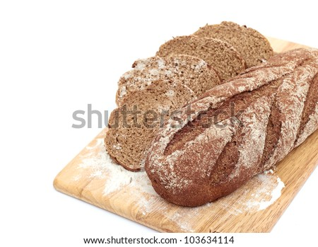 Fresh bread with ear of wheat isolated on white