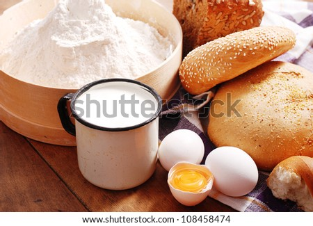 Fresh bread with ingredients for cooking in rustic style