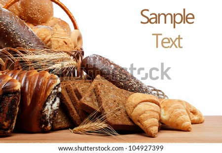 Fresh breads for a variety isolated on white. - stock photo