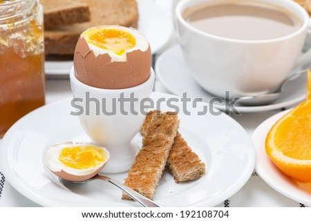 fresh breakfast with eggs, toast and coffee with milk, close-up, horizontal