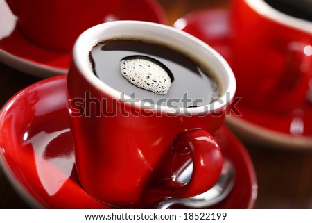 fresh brewed coffee in a red cup - stock photo
