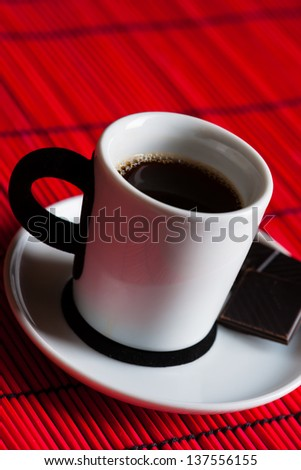 fresh brewed coffee over red background