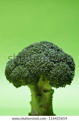 Fresh broccoli against green backdrop