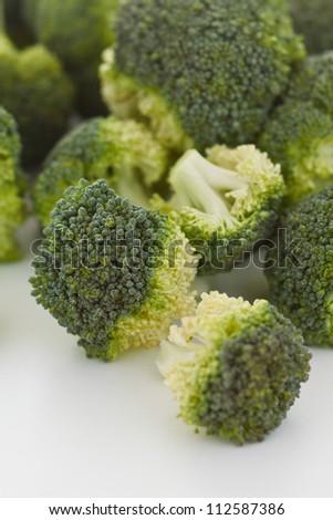 Fresh broccoli florets isolated on white