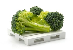 Fresh broccoli on a pallet isolated on white background
