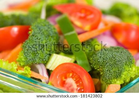 Fresh broccoli salad with lettuce, broccoli and tomato
