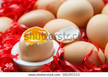 fresh brown eggs and one eggs is broken in cup