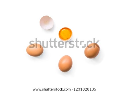 fresh brown organic chicken eggs broken with yolk and egg white isolated on white background. Horizontal composition. Top view