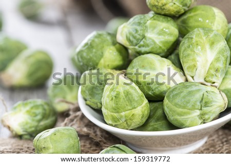 Fresh Brussel Sprouts (raw) on wooden background