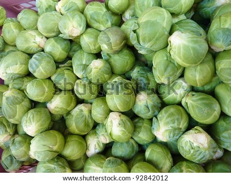 Fresh Brussels sprouts in a box at the greengrocer on the market place