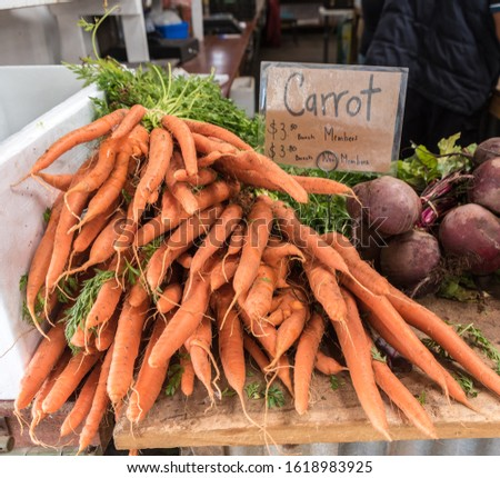 Fresh Bunches of Carrots at a Farmer's Market - South Australia