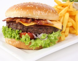 Fresh Burger with ham, cheese, salad and french fries
