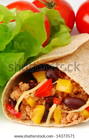 Fresh burrito with meat and beans