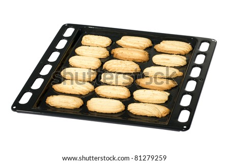 Fresh butter shortbread biscuits on a baking tray isolated over white.