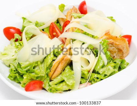 fresh Caesar salad with ham and tomatoes