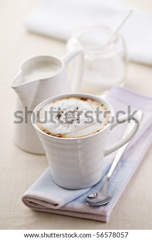 Fresh cappuccino with milk and sugar close up shoot