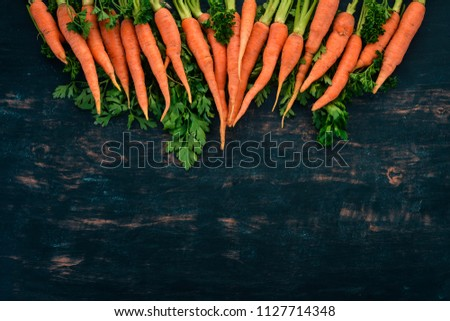 Fresh Carrot. Fresh vegetables. On a wooden background. Top view. Copy space. #1127714348