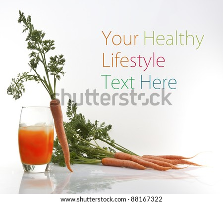 fresh carrot juice in glass isolated on white background with copy space for text