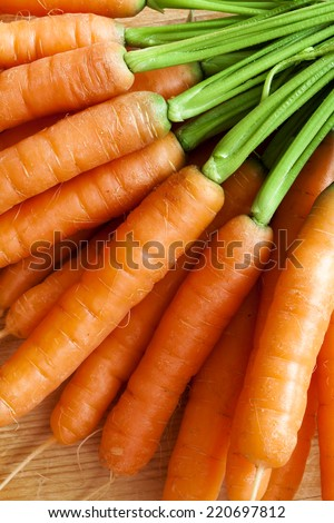 fresh carrots bunch on wood