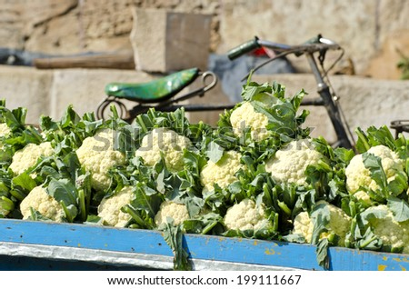 fresh cauliflower vegetable in asia street market and bicycle fragment